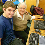 Teens helping Senior with computers on Senior Tech Day
