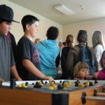 Teens playing foosball